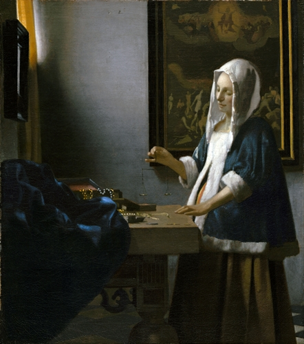Vermeer - Woman holding a balance