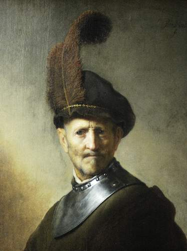 An old man in military uniform by Rembrandt